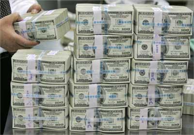 $100 notes at a bank.