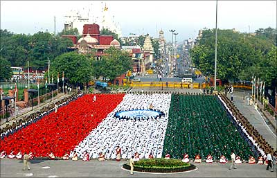 Children dressed in the colours of the national flag rehearse in front of Red Fort, New Delhi.