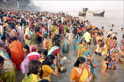 Devotees take a dip in the holy Ganges during the Chhat Puja celebrations in Patna