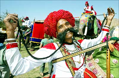 Ramnath Choudhary shows off his long moustache during an elephant festival in Jaipur.