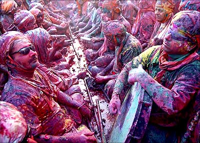 People celebrate Holi, the festival of colours, at Nand Gaon in Uttar Pradesh