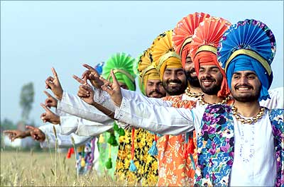 Farmers perform the Bhangra, a traditional Punjabi dance, on the eve of the Baisakhi festival
