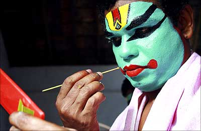 An artist gets ready to perform during the festivities marking the start of the annual harvest festival, Onam, in Kerala