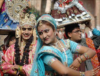 Folk dancers from Madhya Pradesh perform Gangaur dance.