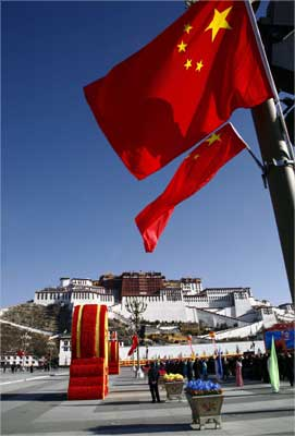 Chinese national flags fly in front of the Potala Palace in Lhasa, Tibet.