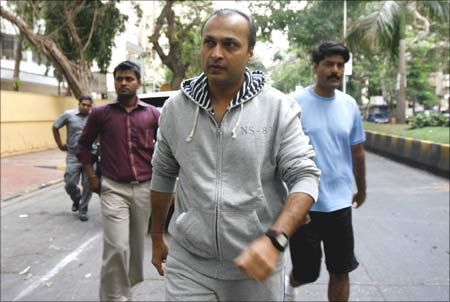 Anil Ambani, chairman of Anil Dhirubhai Ambani Group, surrounded by bodyguards, going to cast his vote at a polling centre in Mumbai on April 30.