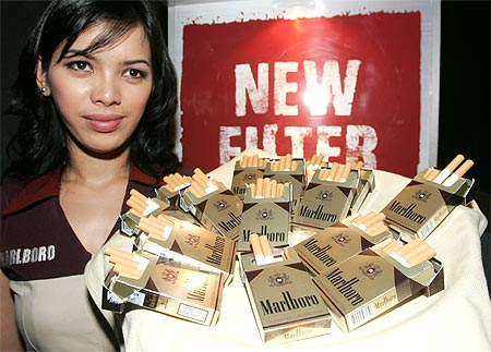 A saleswoman stands next to the Marlboro Mix 9 kreteks during its launch in Jakarta