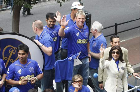 Members of the Rajasthan Royals cricket team wave to crowds during a street parade in Cape Town by teams competing in the Indian Premier League T20 cricket tournament.