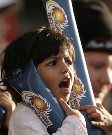 A cricket fan watches during the 2009 Indian Premier League T20 cricket tournament match.