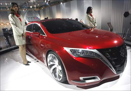 Models stand next to Maruti-Suzuki's Kizashi concept car, which could be launched in India.