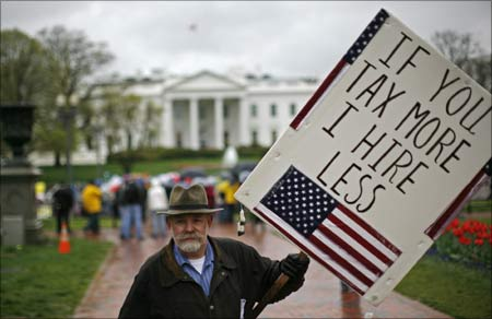 A man participates in a rally as part of national Tax Day in Lafayette Park across from the White House in Washington.