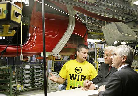 German Foreign Minster Frank-Walter Steinmeier and Opel CEO Hans Demant