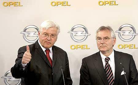 German Foreign Minster Frank-Walter Steinmeier and Opel's German CEO Hans Demant