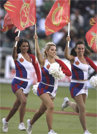 Bangalore Royal Challengers dancers entertain fans during the 2009 Indian Premier League T20 cricket tournament between the Mumbai Indians and the Bangalore Royal Challengers.