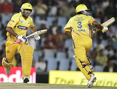 Chennai Super Kings captain Mahendra Singh Dhoni (L) makes a run with Suresh Raina during their 2009 Indian Premier League (IPL) T20 cricket tournament against the Rajasthan Royals in Centurion.