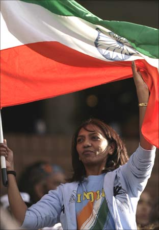 A cricket fan waves an Indian national flag during the 2009 Indian Premier League (IPL) T20 cricket tournament.