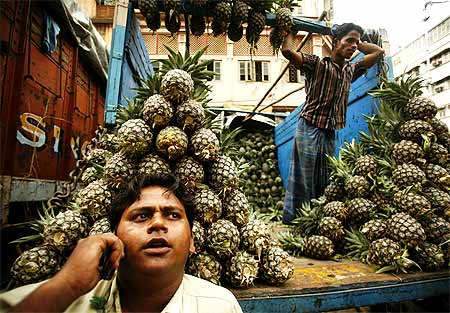 A pineapple fruit seller in Kolkata speaks o