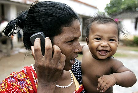 A Christian woman speaks on a mobile phone at a refugee camp in Bhubaneswar, Orissa.