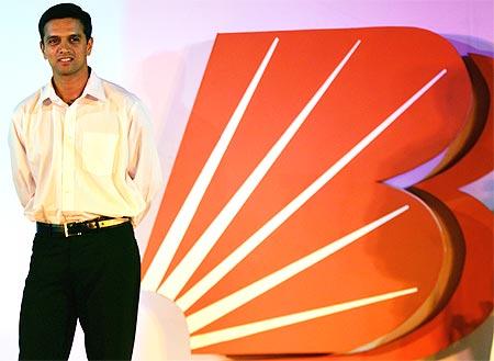 Indian batsman Rahul Dravid poses to mark the rebranding of Bank of Baroda.