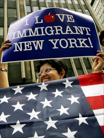 A woman holds an American flag during the naturalisation ceremony for new citizens in New York.