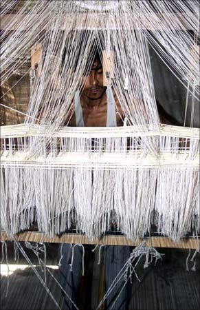 Nandu Chowdhry works on a handloom to make a silk cloth in the village of Sualkuchi in Assam.