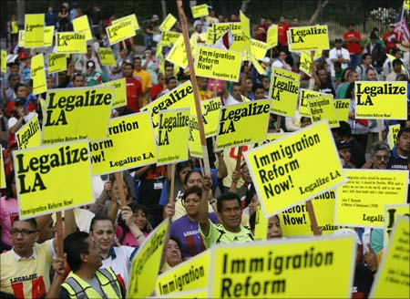 People take part in a May Day rally protest march for immigrant rights.