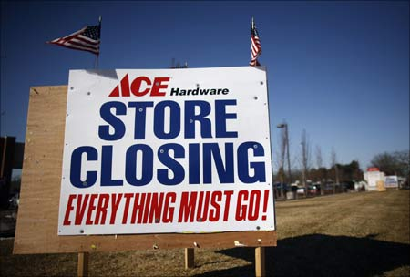 Signs advertising a store closing in Islip, New York.