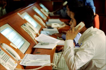 Indian brokers engage in trading at a brokerage firm in Mumbai.