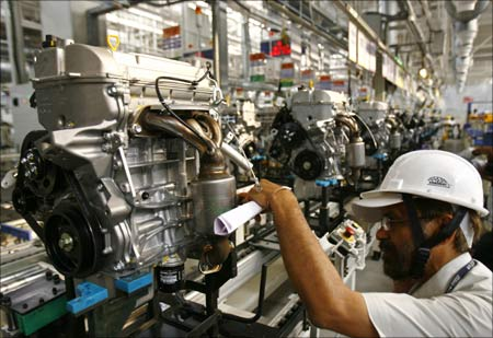 An employee works inside Maruti Suzuki's newly launched petrol engine plant on the outskirts of New Delhi.