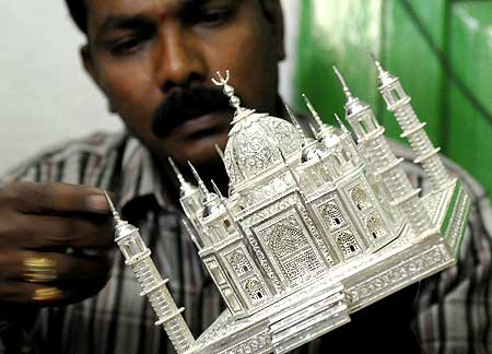 Silversmith Krishna Chary works on a miniature replica of the historic Taj Mahal.