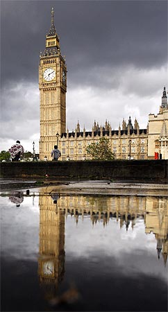 Britain's Houses of Parliament and Big Ben clock tower are reflected in a puddle