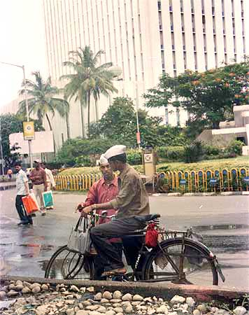 Two dabbawallahs talk in a Mumbai street