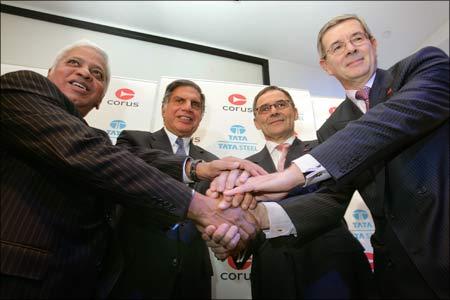 B Mutharaman, Tata Steel MD; Ratan Tata, Tata chairman; J Leng, Corus chair; and P Varin, Corus CEO.