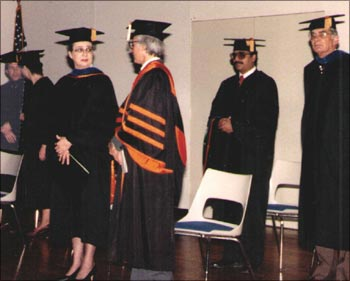 On graduation day, Jain is second from right with advisor Frank Bass.