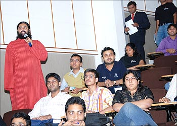 Participants ask questions at the event.