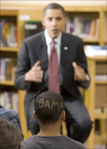 A student with an 'Obama haircut' at Wright Middle School in Madison, Wisconsin, listens to US President Barack Obama speak.