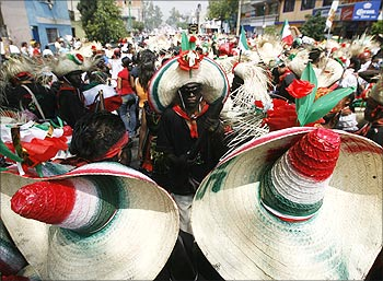 Mexicans wearing period costumes re-enact the battle of Puebla in Mexico City.