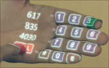 SixthSense can just project a dailler on your palm and you can call a number by tapping on the keys on your hand!