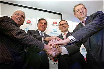 B Mutharaman, Tata Steel MD; Ratan Tata, Tata chairman; J Leng, Corus chair; and P Varin, Corus CEO.
