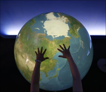 Tangible Earth, a digital globe in which real time global metrological data is fed through the Internet from about 300 places in the world.