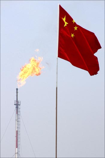 A Chinese flag flutters at the Jidong Nanpu oilfield in Bohai Bay.