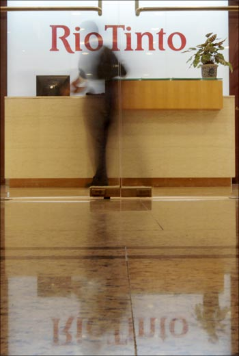 An employee walks past the reception area at the Rio Tinto Ltd Shanghai office.