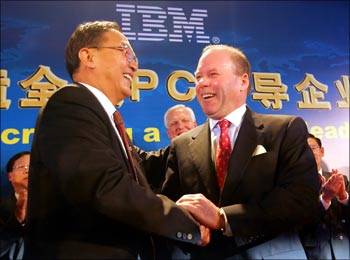 Lenovo chairman Liu Chuanzhi with John Joyce, Sr VP, IBM in Beijing.