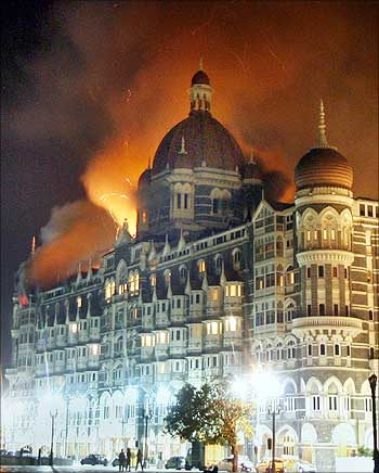 Smoke and flame billow from the Taj Hotel in Mumbai on November 27, 2008.