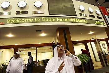 An investor talks on the phone at the opening of Dubai Financial Market.