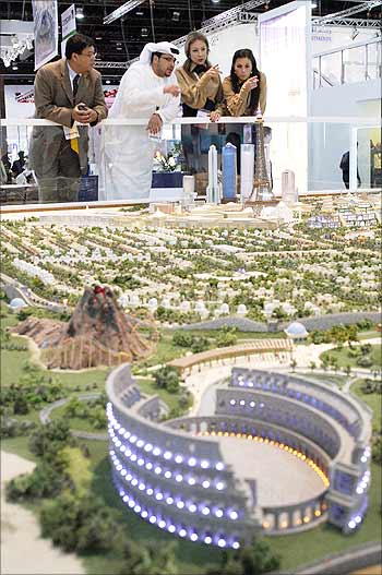 Visitors look at models of new real estate projects in Abu Dhabi.