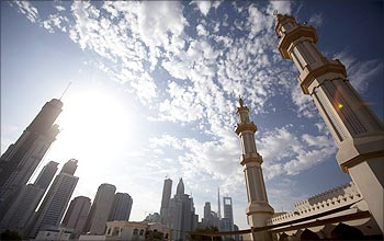 The twin minaretes of a mosque are seen with office towers along Sheikh Zayed Road in Dubai.
