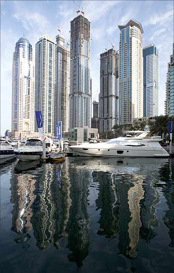Residential tower blocks are reflected in the waters of Dubai Marina.