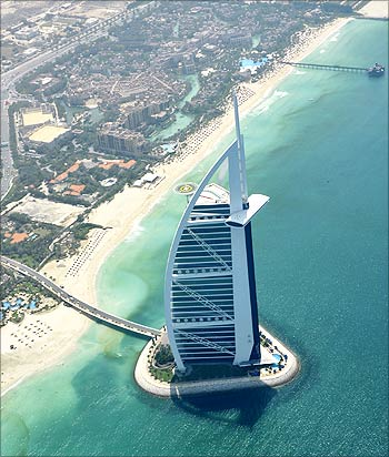 An aerial image with the Burj Al Arab in the foreground.