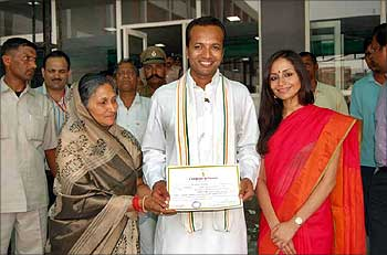 Navin Jindal with his mother Savitri Jindal and wife Shallu Jindal.